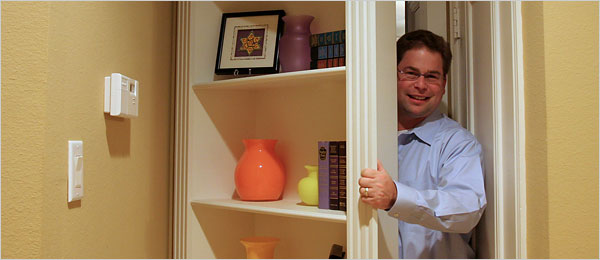 "David Lee of Plano, Tex., got a bookcase door to hide the mess of his workroom, but also because he had wanted a secret room, he said, ""since watching Scooby-Doo way back when."""