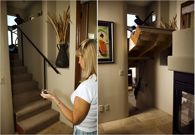 Louise Kircher raises the staircase in her home in Mesa, Ariz., to reveal the secret room behind it.
