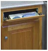 unfinished kitchen cabinet with tilt-out tray